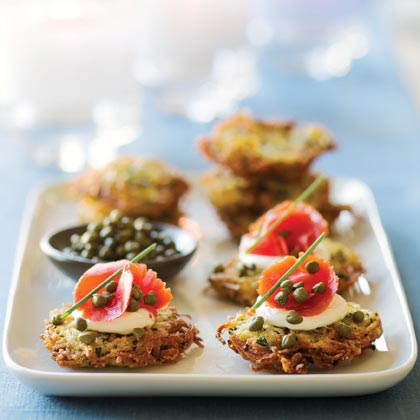 Herbed Yukon Gold Potato Latkes RecipeServe a delicious potato-and-salmon appetizer that looks almost as good as it tastes. The salmon adds a bright pop of color to the appetizer buffet, and the potato base gives this appetizer top-rated portable ability.