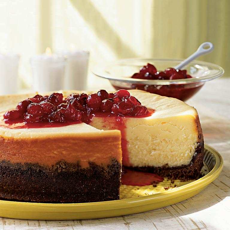 White Chocolate Cheesecake with Cranberry Currant Compote RecipeAs if the rich white chocolate filling and the thick chocolate wafer crust weren't enough, this cheesecake is crowned with a juicy cranberry topping that soaks into the cake and adds more tart, sweet flavor.