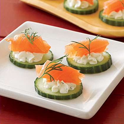 Pile cucumber slices with salmon and a garlicky cheese dip for easy, crowd-pleasing appetizers.Northwest Salmon Canapés Recipe
