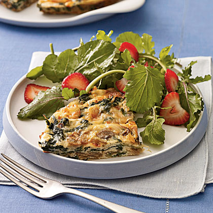 """""""Fabulous frittata. The smoked gouda gives it so much flavor and the portion size is very satisfying. Easy too! We actually served four with some oven-baked fries and a tossed salad for a casual, light meal."""" —northcountrycookMushroom and Spinach Frittata With Smoked Gouda Recipe"""