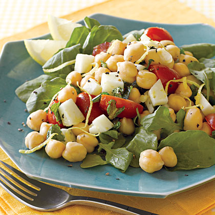 Mediterranean Chickpea Salad RecipeCreate a colorful salad that's packed with protein by combining chickpeas, tomatoes, and arugula. The salad is also full of flavor from the mixture of manchego cheese, lemon zest, and mint.