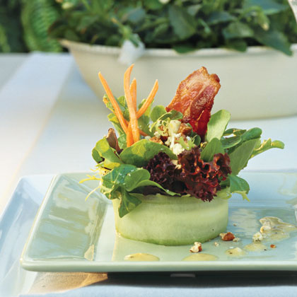 The Art of the Meal RecipeImpress guests with simple-to-prepare Bacon-Blue Cheese Salad with White Wine Vinaigrette. Serving it in individual cucumber rings gives the salad an extra-special touch that's easier than it looks. Using a Y-shaped vegetable peeler, cut cucumbers lengthwise into very thin strips just until seeds are visible. Shape the largest strips into wide rings and wrap them evenly with the remaining slices.