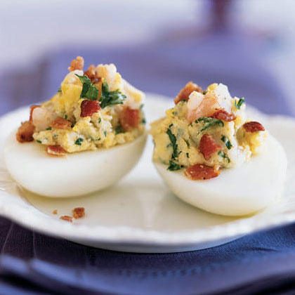 Shrimp and Bacon Deviled Eggs RecipePotato flakes add bulk to the filling so you can use less yolk and decrease the overall fat, calories, and cholesterol. The shrimp, bacon, and parsley add extra color and flavor, resulting in an impressive finish.
