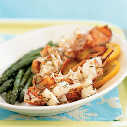 Champagne and Orange-Steamed Lobster Tails RecipeWhen money is no object, don't just sip Champagne–cook in it as well. Top sweet, tender lobster and crisp fennel with butter and sparkling wine, then steam in parchment paper packet for an elegantly simple entrée.