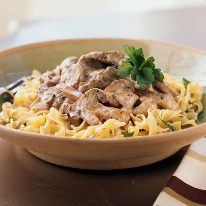 Beef Stroganoff RecipeThis classic Russian dish combines tender slices of sirloin steak with sautéed onions and earthy cremini mushrooms. An easy roux thickens the tangy sour cream sauce, which lends great flavor to the meat and veggies. Serve over wide egg noodles for a super satisfying supper.