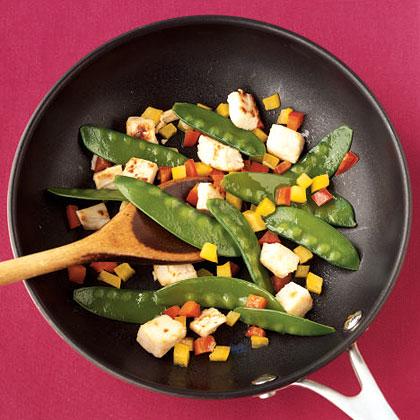 Sauteeing vegetables in pan