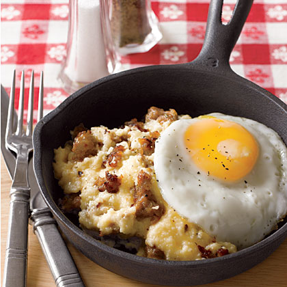 <p>Sausage and Cheddar Grits with Fried Eggs</p>