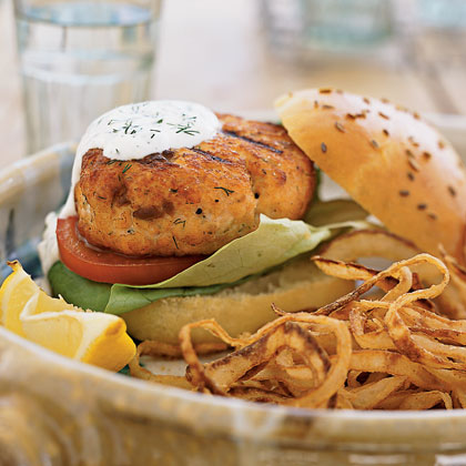 Fresh Salmon Burgers RecipeTake a break from your traditional beef burgers with this healthy option. This flaky salmon patty placed between slices of warm, crusty Lemon-scented Challah Buns is perfection on a plate.