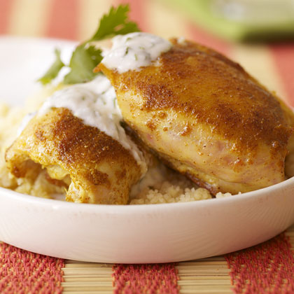 Spiced Chicken Thighs with Yogurt Sauce RecipeOne of our most popular weeknight suppers, Moroccan spice-rubbed skinless chicken thighs are topped here with an easy yogurt sauce made with minced garlic and chopped cilantro. The sauce is also great with roasted lamb or drizzled over steak tacos.