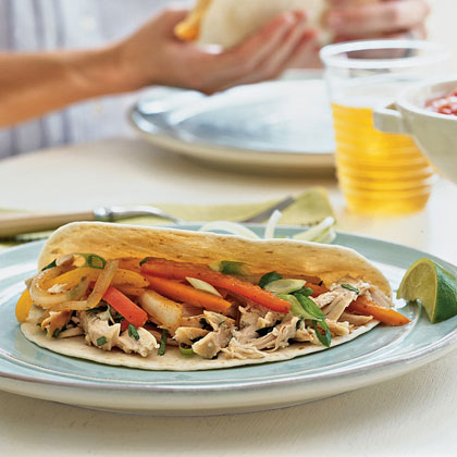Sprint to the dinner table with a recipe that calls for the ultimate weeknight timesaver: rotisserie chicken. Chop the cooked bird into bite-size pieces drizzle with a lime juice and cilantro dressing before layering with sautéed bell peppers and your favorite toppings.Recipe: Chicken Fajitas