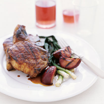 Five-Spice Pork Chops with Grilled Plums Recipe | MyRecipes