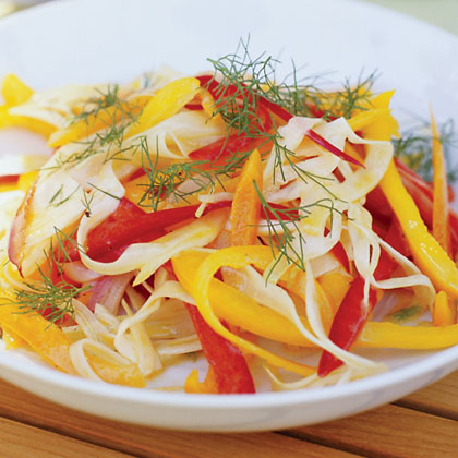 Fennel-Pepper Slaw RecipeDrizzle sweet bell peppers and thinly sliced fennel with a homemade lemon vinaigrette for a refreshingly crisp, crunchy salad. Serve it on the side, or fold the colorful mixture into wraps and sandwiches.