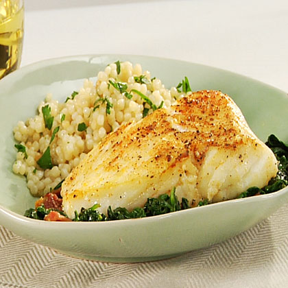 Add savory flavor to fresh fish with smoked paprika, black pepper and bacon, and serve the fish over a bed of fresh spinach.Spanish-Style Halibut