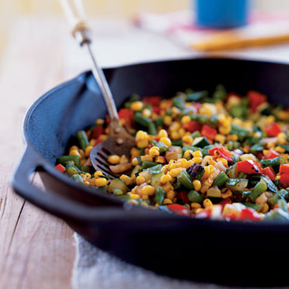 Charred Summer Vegetables RecipeGive corn, zucchini, and green beans a smoky flavor without firing up the grill by letting them sear and steam in a preheated cast-iron skillet for just 5 minutes. If fresh corn is out of season, substitute thawed frozen corn kernels, then serve this dish as a side or a chunky sauce over fish, chicken, or pork.