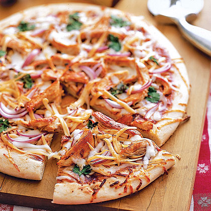 Barbecue Chicken Pizza RecipeLose the bun and move shredded barbecue chicken onto a pizza crust for a tasty fusion of Italian and Tex-Mex flavors. Smoky Gouda cheese adds rich flavor to the tangy pie, flavored with cilantro and red onion. Start with store-bought crust to save time on a busy weeknight.