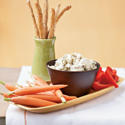 "Creamy Artichoke Dip RecipeGuaranteed to be the ""hit of the party,"" this oven-baked favorite combines cream cheese, light mayonnaise, and artichoke hearts with Parmesan cheese. Be sure to use frozen artichoke hearts for the best flavor; canned ones just don't compare."