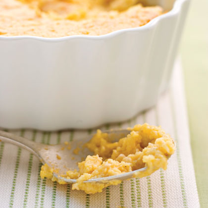 "Creamy Grits Casserole RecipeCelia never met a pork chop she couldn't burn, but she could do up grits like the queen of Sugar Ditch. If grits are a regular on your breakfast or brunch menu, try this decadent twist: Grits Casserole. Flavored with Gouda, Cheddar, and a dash of red pepper, these grits are no sides dish—they're the star of the show. As Abilene says, ""That's all grits is, a vehicle. For whatever it is you rather be eating."" Melty cheese, anyone?"