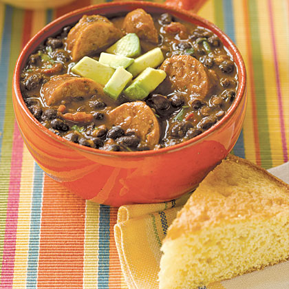 Black bean soup gets an upgrade with the addition of hot Italian sausage. The ingredients in this dish are simple, allowing you to customize your toppings. We like diced avocado and tomatoes, shredded mozzarella cheese, and crumbled cornbread.Black Bean Soup with Sausage