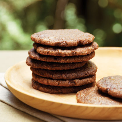 Ginger Chocolate Cookies RecipeIf you love anything sweet and spicy, then these cookies are for you. Brown sugar, white sugar, and molasses mellow the ginger's spicy bite for an irresistible combination. If you prefer softer, rounded cookies to flat, crisp ones, don't flatten the balls of dough.
