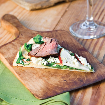 Grilled Pizza With Steak, Pear, and Arugula RecipeEverything's better on the grill, including pizza! Top your favorite prebaked crust with grilled flank steak, crisp pears, fresh arugula and Gorgonzola cheese.