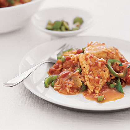 Spanish Chicken and Rice RecipeSimmer seasoned chicken breast pieces, veggies, and rice together in a tomato and wine-based sauce for a flavorful and low-fat one-dish meal. Top the finished dish with chopped olives for a Spanish flair.