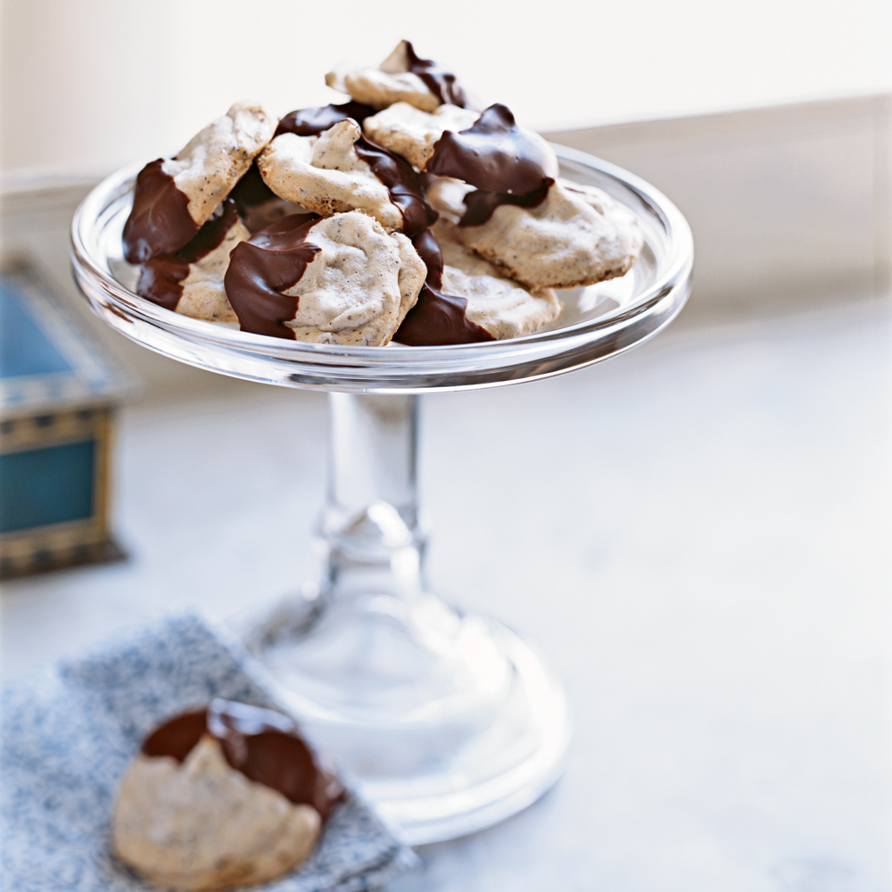 Chocolate-Dipped Almond Meringues RecipeCrispy, light almond meringues get a special touch when you dip them in semisweet chocolate.