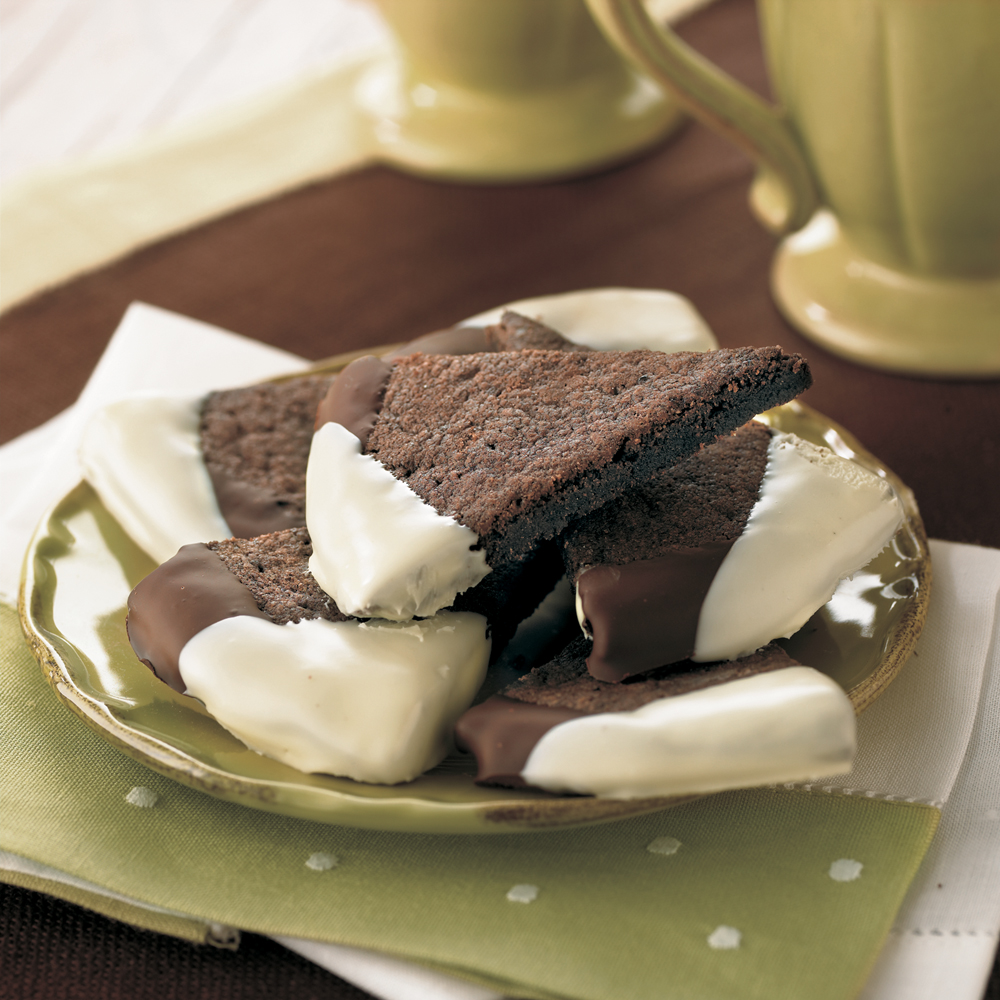 Chocolate-Espresso Shortbread RecipeEdges tipped with unsweetened chocolate and white chocolate enhance the coffee flavor in these cookies.