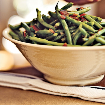 Green Beans with Bacon RecipeSave a little time and prepare this dish up to two days ahead. You can substitute chopped onion for the shallots.