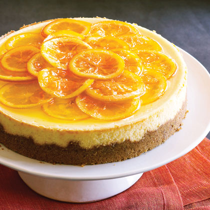 Orange Ribbon Cheesecake RecipeThe beauty of this cheesecake is in the caramelized, candylike topping made from orange slices. The citrus-meets-sweet combination is a definite crowd-pleaser.