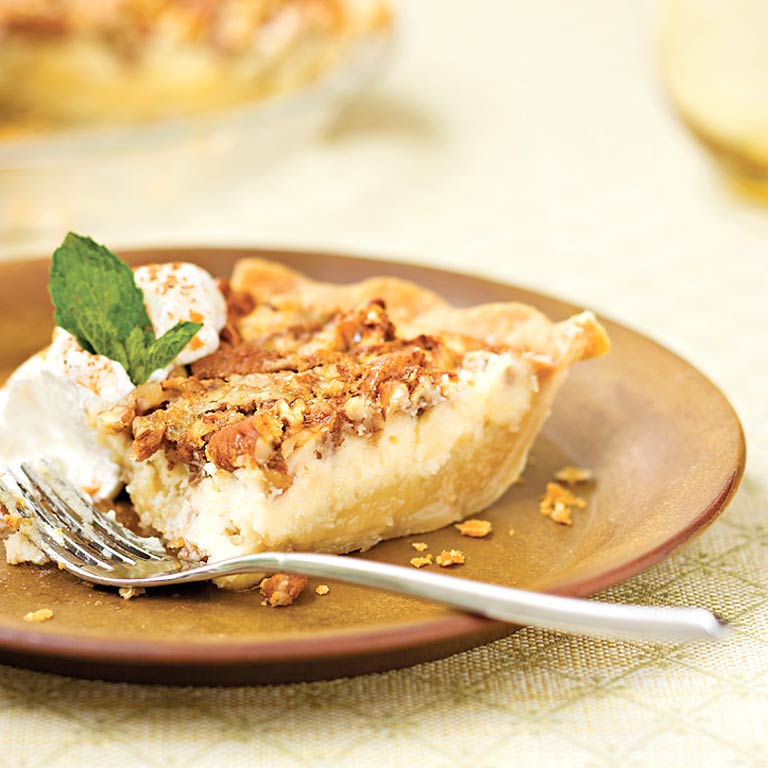 Pecan Cheesecake Pie RecipeServe classic pecan pie in a tasty new form. Simply layer the rich pecan-sugar mixture over the creamy cheesecake filling and bake. Using refrigerated pie crusts keeps prep time to just 15 minutes.