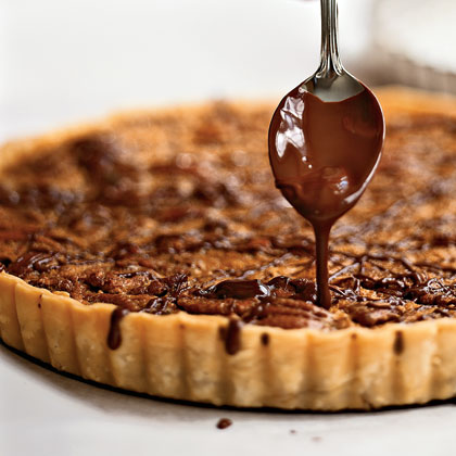 Bourbon-Pecan Tart with Chocolate Drizzle RecipeIndulge in this lightened take on traditional pecan pie. The crust is thin and flakey leaving more room for the sweeneted pecans and rich chocolate drizzle.