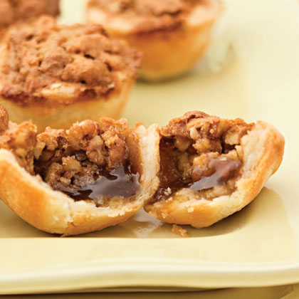 Pecan Tassies RecipeThese mini pecan pies are just the right size to pick up with your fingers—no forks or plates required.