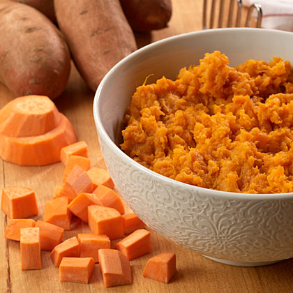 "Though sweet potatoes are not ""potatoes"" at all, you can substitute them for white potatoes in almost any recipe for an extra kick of vitamins A and C. Plus, their rich orange color, sweet taste, and creamy texture rank them among our favorite holiday foods."