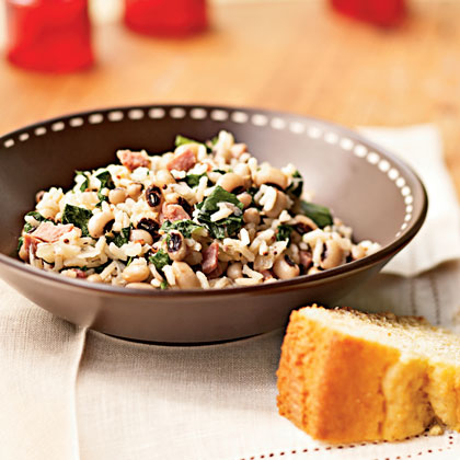 "This quintessential Southern dish features black-eyed peas, ham, rice, and greens and was likely introduced to America by African slaves who worked on the rice plantations. There are several legends about the origin of the name, but our favorite is that a man named John ""came hoppin' to the table"" when his wife made this dish.Recipe: Hoppin' John with Mustard Greens"