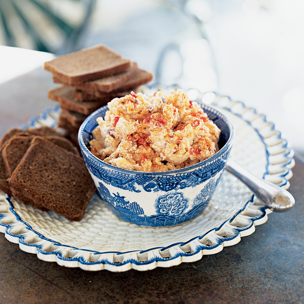Pimiento Cheese Canapés RecipeReducing the fat in pimiento cheese is as easy as substituting fat-free cream cheese, reduced-fat Cheddar and low-fat mayonnaise for the full-fat products. And you can kick up the flavor with Worcestershire sauce, red pepper and smoked paprika.
