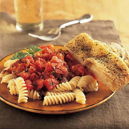 There are a number of different definitions of a marinara sauce, but it's typically some kind of tomato sauce, either from fresh or canned tomatoes. It's a versatile sauce, but you'll often see it spooned over pasta.Recipe: Marinara Sauce over Rotini