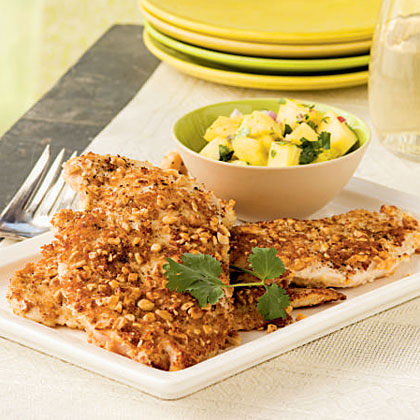 Pick up a container of fresh pineapple chunks in the produce section of the supermarket; chop into half-inch pieces for the salsa. Serve with steamed broccoli and warm rolls to complete the dinner.Watch the VideoPeanut-Crusted Chicken with Pineapple Salsa Recipe