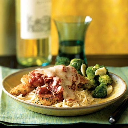 Herbed Chicken Parmesan RecipeThis lightened version of Chicken Parmesan takes less than 15 minutes to prepare. Serve with rice-shaped orzo pasta and a side of broccoli for your dinner tonight. Get Holley's Recipe Tips