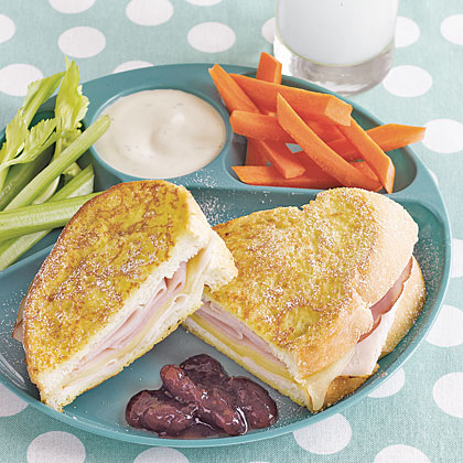 Monte Cristo Sandwiches RecipeThis savory and sweet sandwich features ham, turkey and cheese piled between pieces egg-battered bread and sprinkled with powdered sugar.  For extra sweetness, serve with jam.