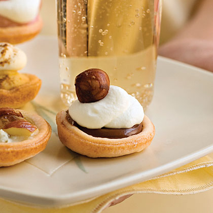 A jar of Nutella spread, a refrigerated pie crust, and whipped cream are all you need for this last-minute dessert.Chocolate-Hazelnut Tartlets Recipe