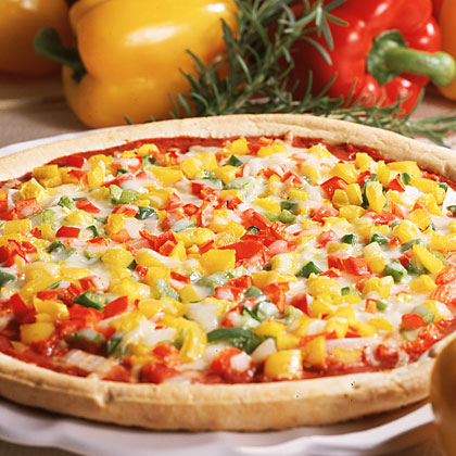 Three-Pepper Pizza RecipeIn less time that it takes to have pizza delivered, this easy six-ingredient pie can be on the table. Start with refrigerated dough for the base, crown with a little tomato paste, and top with a variety of diced peppers and onion for a colorful, flavorful veggie pizza.
