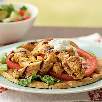 Chicken Shawarma                            RecipeShawarma is a Middle Eastern dish of garlicky meat or poultry served on pitas. This chicken version is flavored with a savory yogurt sauce.