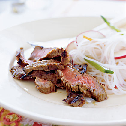 Southeast Asian Grilled Flank Steak RecipeAdd a little heat to the marinade with Sriracha, a hot chile sauce, and balance that kick with tangy lime juice, fish sauce and sugar. This dish is a great choice for entertaining because you can start marinating it a day ahead.