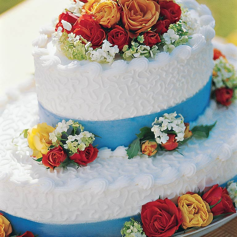 The Garden Bridal Cake is a wonderful option for smaller, less formal ceremonies. A beautiful bouquet of fresh flowers and blue ribbon reflects its summery garden theme. Recipe: Garden Bridal Cake