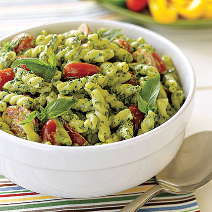 Depending on your tastes, and your crowd, pasta salads make a great side dish or main course for outdoor gatherings. Bring a large batch of one of our 12 delicious pasta salad recipes to the next neighborhood block party or casual park gathering. Keep salads cool by nestling serving bowls in store-bought bowl chillers or our homemade version–a larger serving bowl filled with ice.