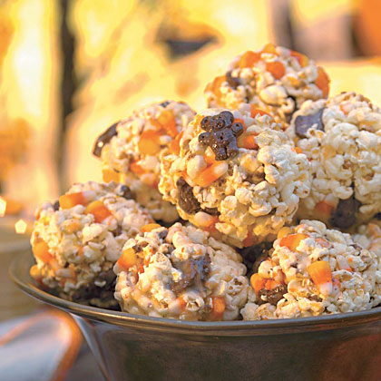 Full of popcorn, teddy bear cookies, and candy corn and glued together by melted marshmallows, this treat will be a hit.Corny Candy Popcorn Balls