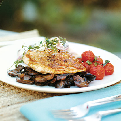 Make a sophisticated dish of pan-roasted chicken by serving it over a savory mixture of sautéed mushrooms and bacon.Chicken on Bacon Mushroom Ragout Recipe