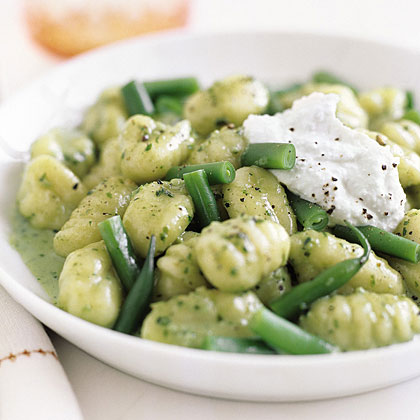 Creamy Pesto Gnocchi with Green Beans and Ricotta RecipeGnocchi are thick, soft noodles that resemble dumplings and are often made from either semolina or wheat flour or potatoes. Cook refrigerated or frozen gnocchi and toss with 2-ingredient pesto cream sauce. Dollop the finished dish with ricotta cheese for an extra creamy boost.