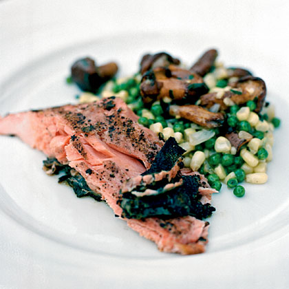 Prepare this elegant feast for a special occasion. The surf and turf menu calls for both grilled rib-eyes and grilled salmon accompanied by heirloom tomatoes and fingerling potatoes. Finish off your guests' appetites with a heaping portion of warm berry compote served a la mode.Menu: Malibu and Vine Menu