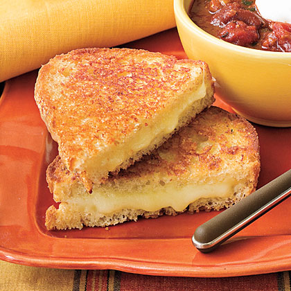 Three kinds of cheese plus bread and butter equals sandwich heaven.Extra Cheesy Grilled Cheese